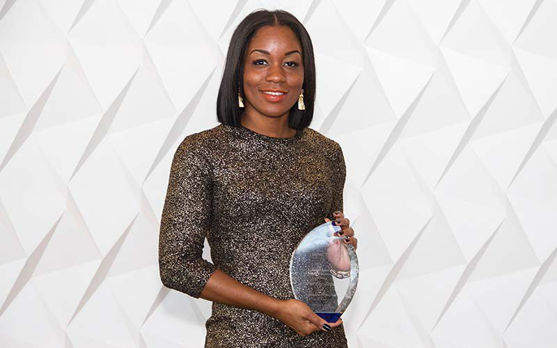 Porche Pope holding her Ambassador of the year award.