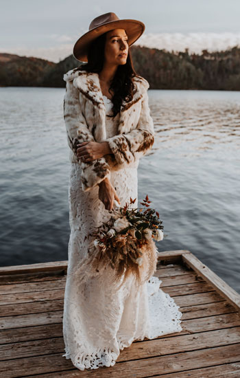 Amanda Dunlap wore a vintage fur jacket purchased from Goodwill with her wedding gown.