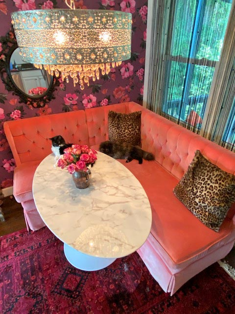 Stephanie Bowman's cats love the banquette, which she estimates originally cost about $10,000. They graciously allow her to use it as a temporary home office during the pandemic.