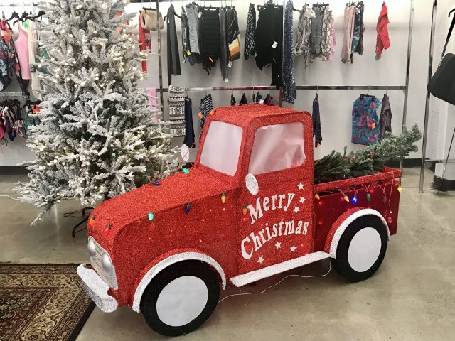 Christmas in July decor featuring a red truck with Merry Christmas on the side.